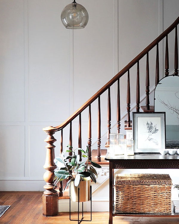 staircase with finished white entryway wall